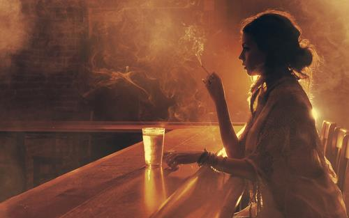 vintage woman on bar smoking