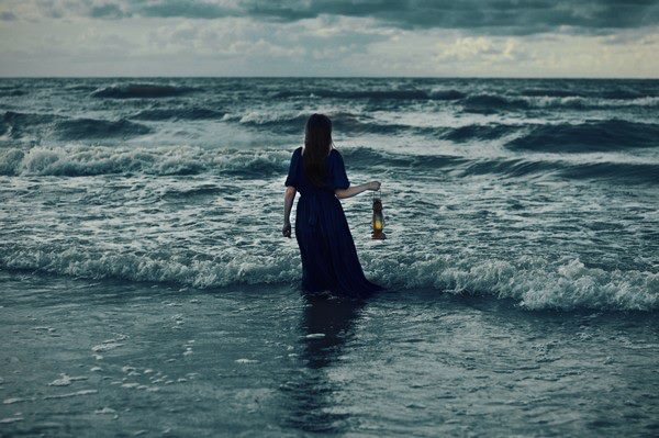 girl with lamp in sea